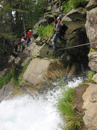 Crossing the falls on the Stuibenfall Via Ferrata