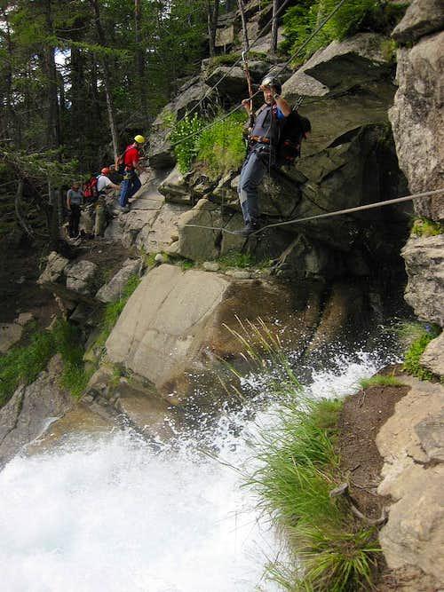 Crossing the falls on the Stuibenfall Via Ferrata