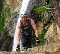 A happy climber topping out on the Lehner Wasserfall Via Ferrata