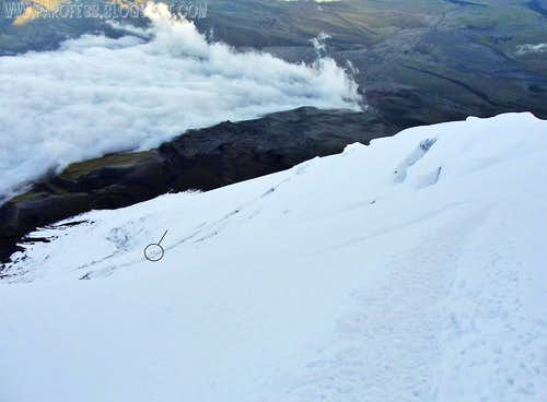 A couple climbers negotiating a huge crevasse on Cotopaxi