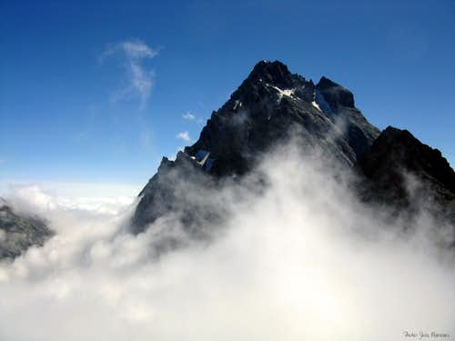 Sea of clouds wrapping Monviso