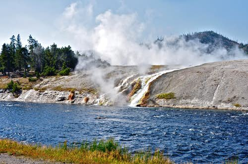 Hot volcanic stream pouring into Firehole River