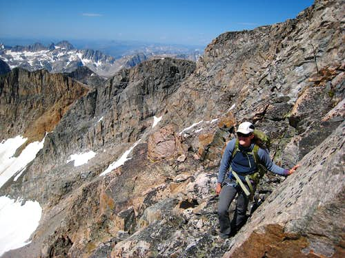 Crossing the ledges on the granite Traverse