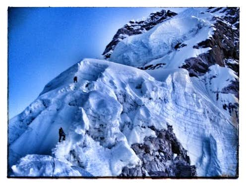 Climbers entering camp 3 on Ama Dablam in the early morning light. cr Ganesh Adventures 2012