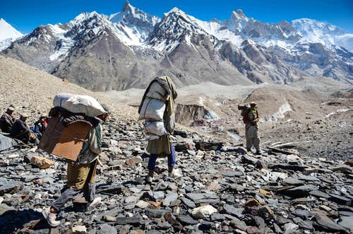 A Sirdar watches over Porters