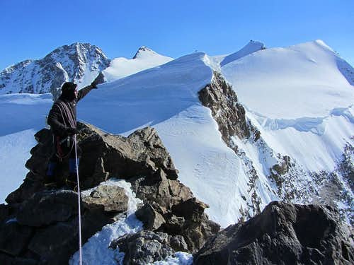 On top of Corno Nero (4321m), with Mark pointing out the peaks we want to climb