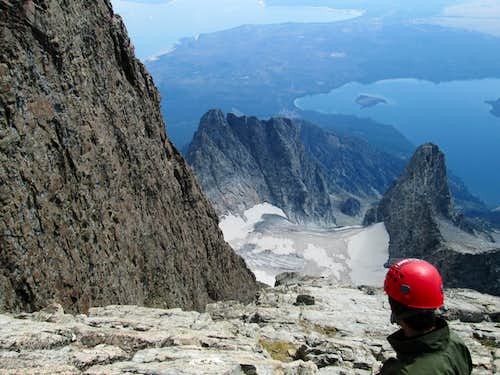 JD looking down the CMC face from near the top of Mount Moran, next to the black dike