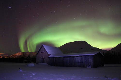 Tromsdalstind under northern lights.