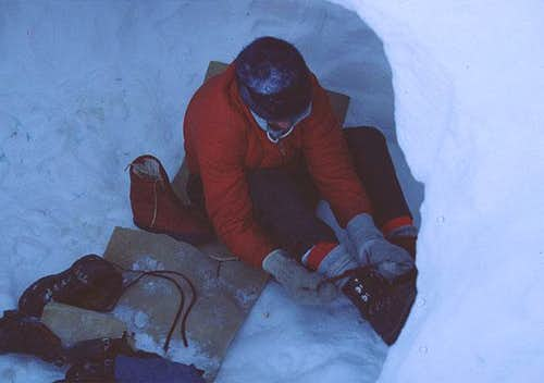 Paul lacing frozen boots with...