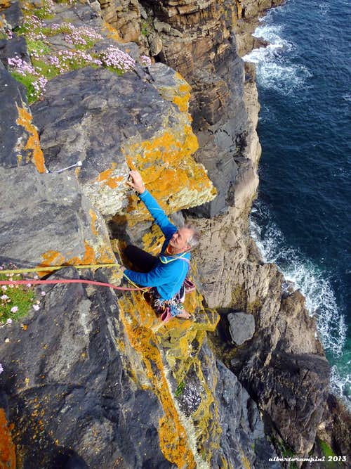 Paul climbing last pitch of Martell Slab, Cornwall