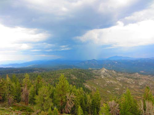 A thunderstorm obscures the view of Kern Peak from the tower