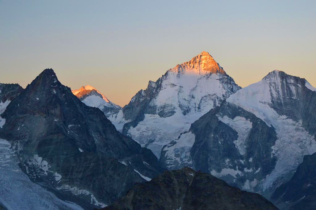 The tips of Dent Blanche and Dent d'Hérens catch the first sunrise light