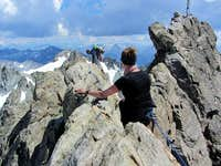 Jannie watches how Hermann negotiates the crux of the route on the Dreiländerspitze