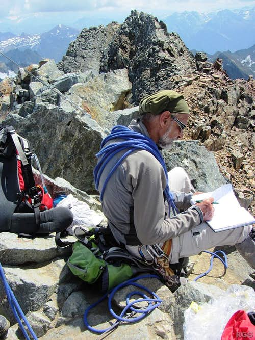 Hermann with the summit log on top of Piz Buin