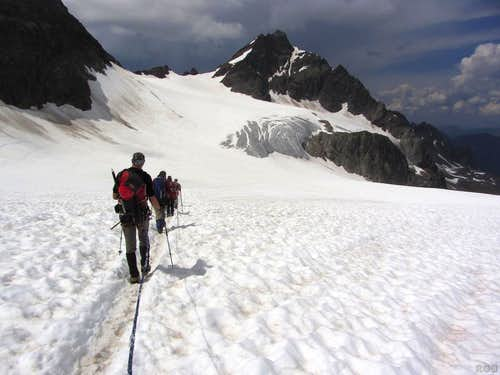 Descending Piz Buin, high on the Ochsental Glacier, with Silvrettahorn in the background