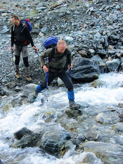 Wilco and Paul are crossing a little mountain stream just below the Vermunt Glacier