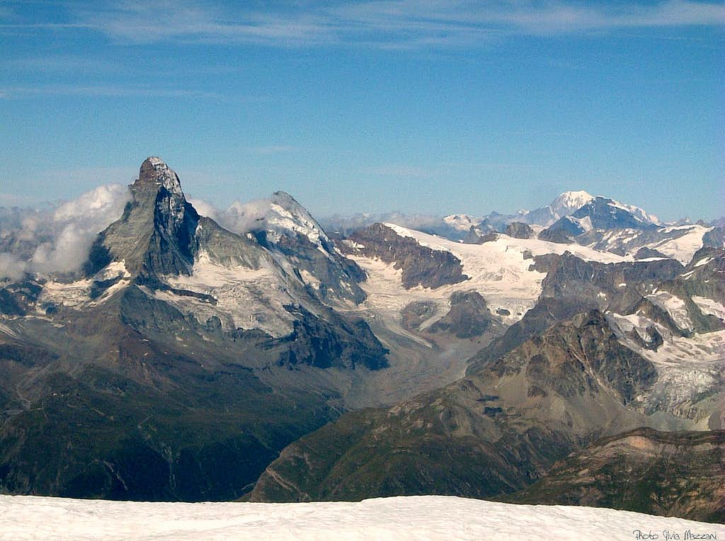 Cervino, Dent d'Herens and Mont Blanc from Alphubel summit plateau