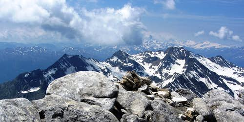 Lodner (3228m) summit view towards the Gfallwand (3175m) and beyond to the distant Ortler group