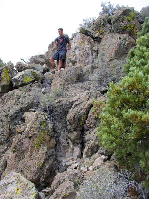 Greg ascending summit rocks