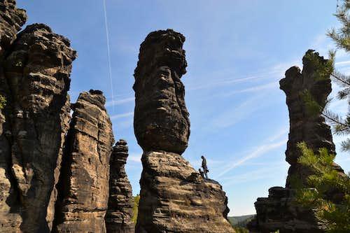 Climbers on the sandstone rocks in Bielatal