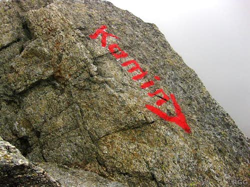 Important sign above the chimney on the east face of Tschigat