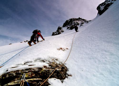 Parties climbing the White Gully (Canale Bianco) on Torricella