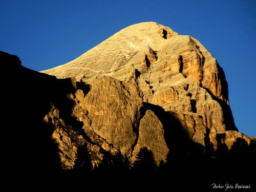 An unwonted perspective of Torri di Falzarego and the gigantic Tofana at sunset
