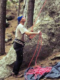 Jan concentrates as he is belaying Rado