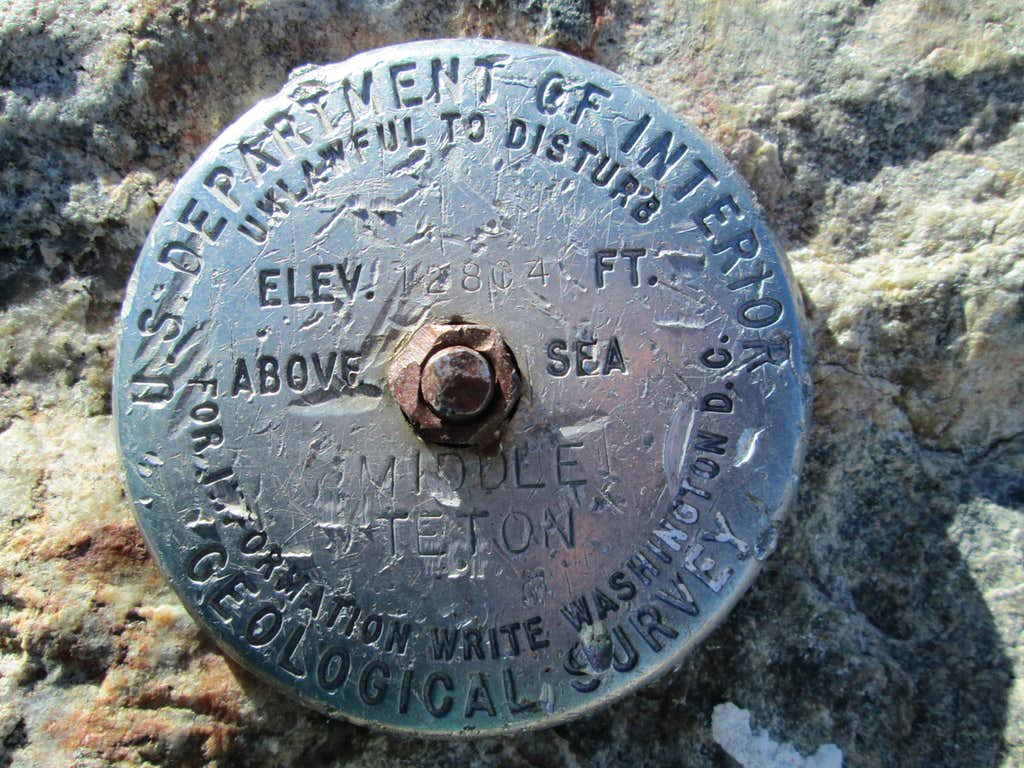The summit marker at the top of the Middle Teton