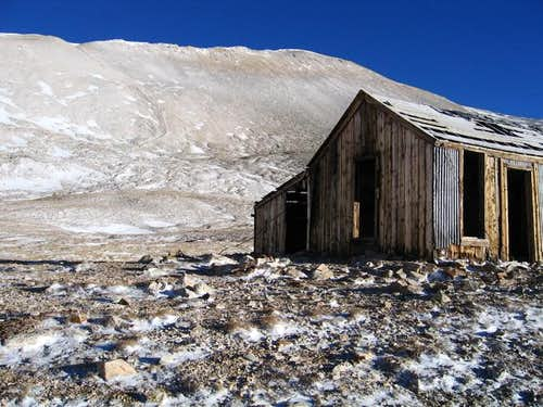 An old mine shack with the...