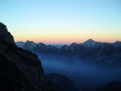 Sunset over the Julian Alps tainted with a little forest fire smoke