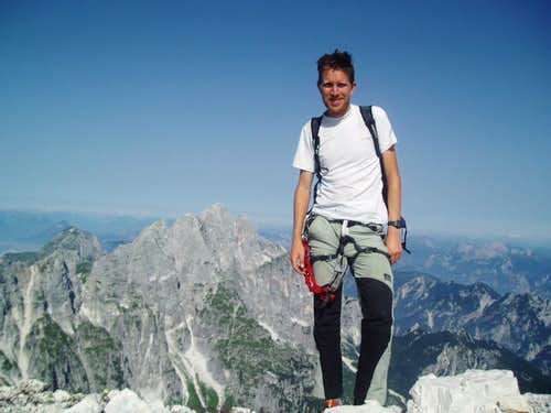 Me on the summit of Fuart, Montasio in the background