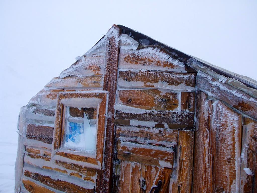Hut during the storm. The window had been broken by flying pebbles, picked up by very strong wind.