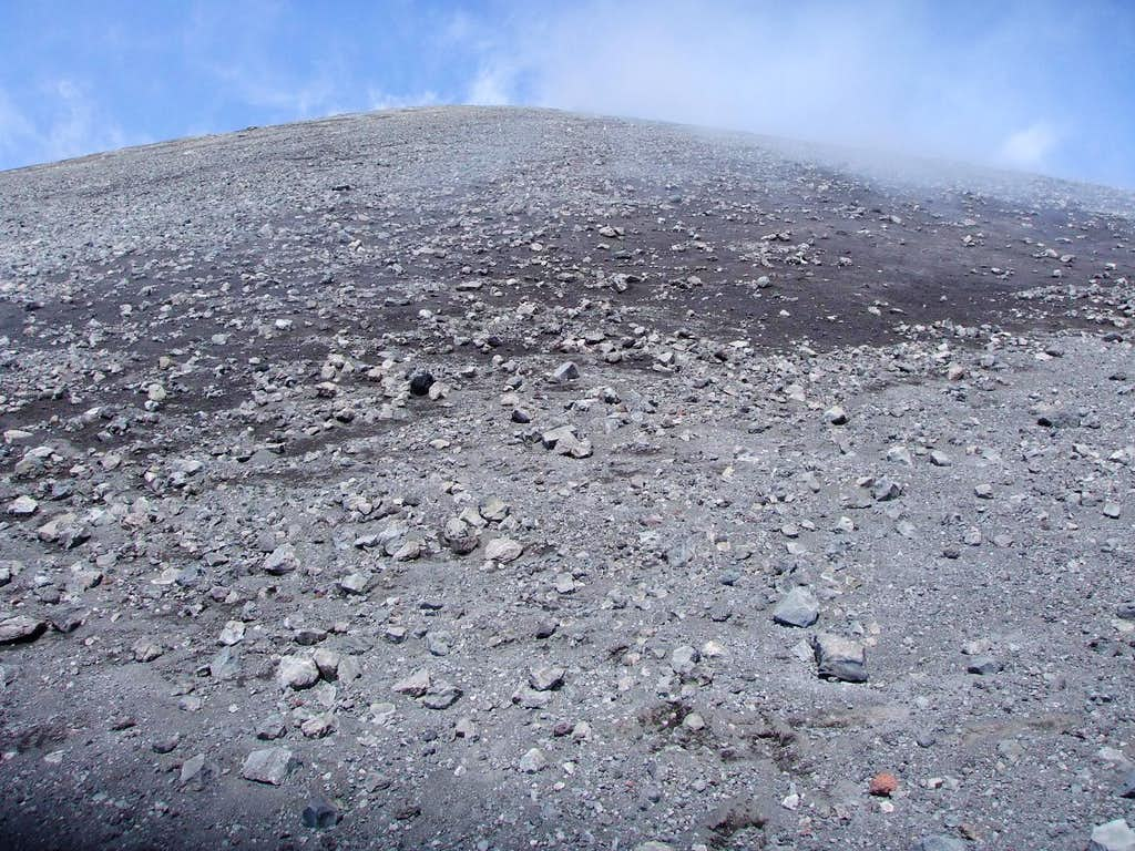 Just below the summit of Klyuchevskaya, noxious fumes steam out of the hot ground.