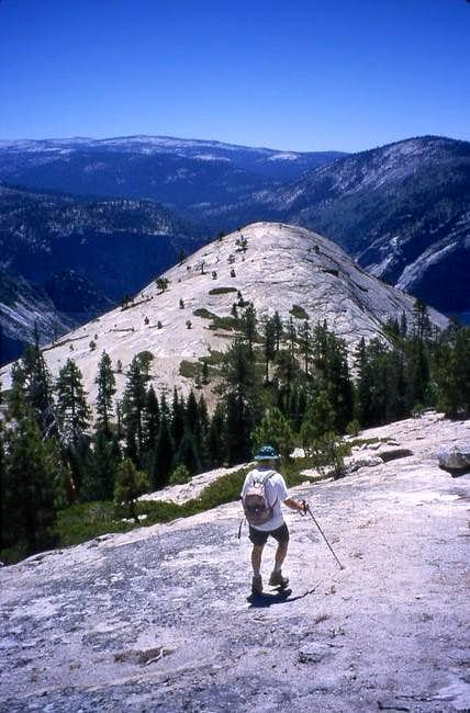 Hiker approaching North Dome...