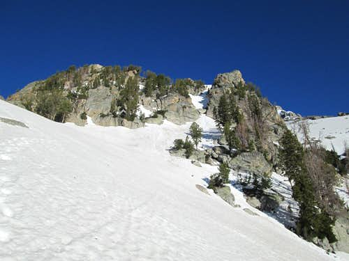 The steep snowy buttress which connects to the main plateau of Disappointment Peak, Teton Range