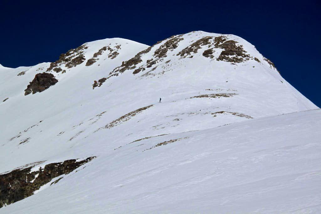 Skier below the summit of Trico Peak