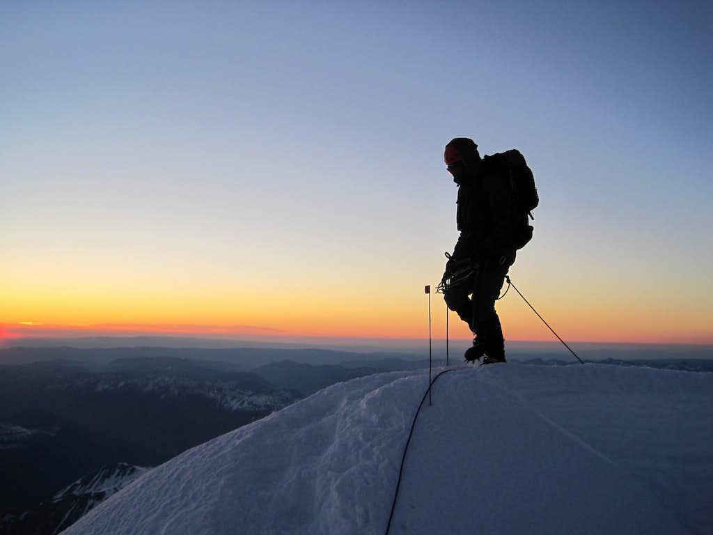Crevasse crossing at dawn (MT Rainier)