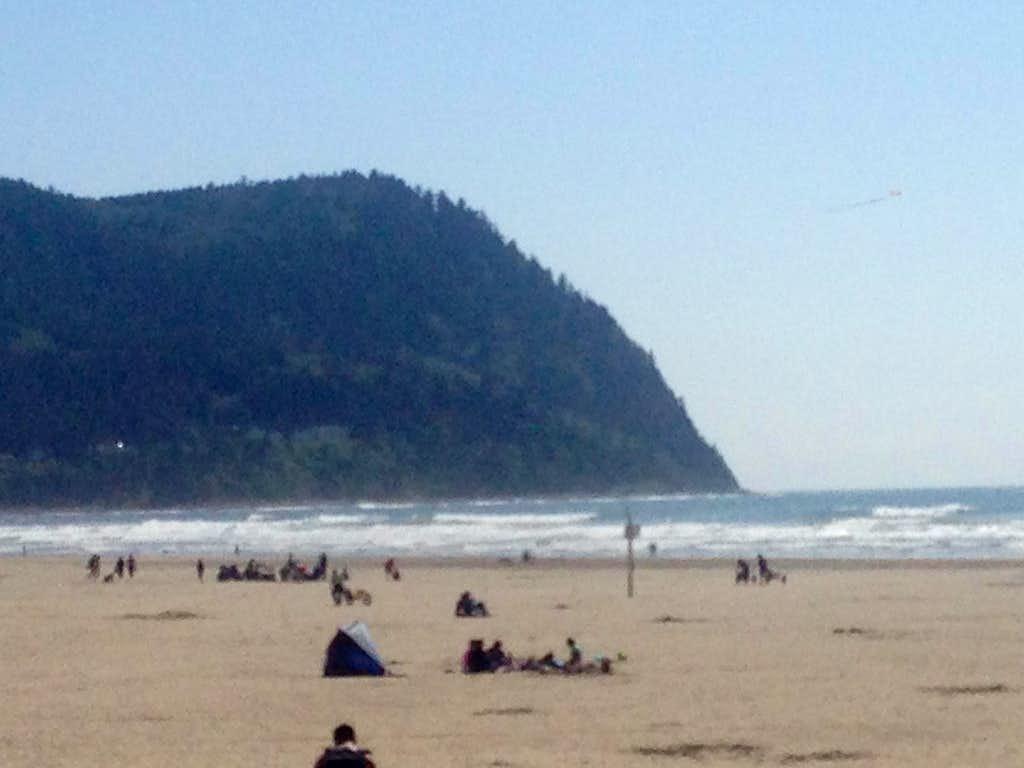 Tillamook Head rising from the Pacific Ocean