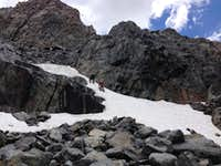 descending the last snowfield to Lake Catherine