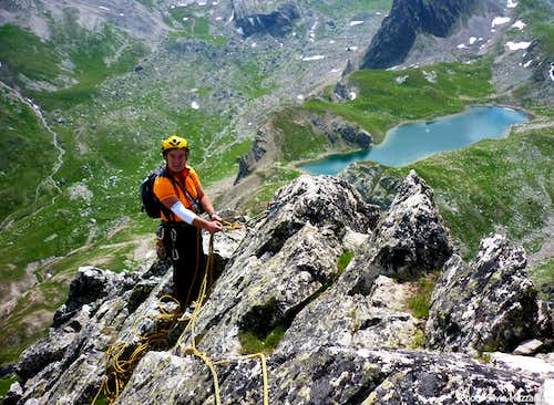 Belay on the summit crest and Marinet Lakes