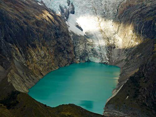 Lake Arhuaycocha with a Glacier Above