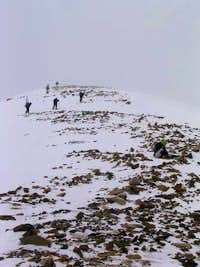 Five skiers approach a very...
