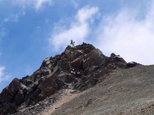 Climber on the summit rocks...