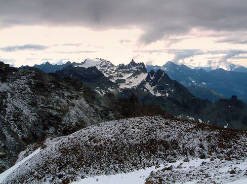 Stormy sky over Dome and Aiguille du Cian seen from Becca di Luseney