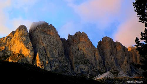 The Alpe di Cisles walls lined up at sunset