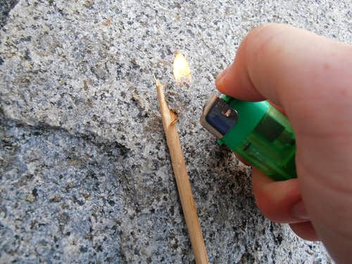 Burning a stick to sign register
