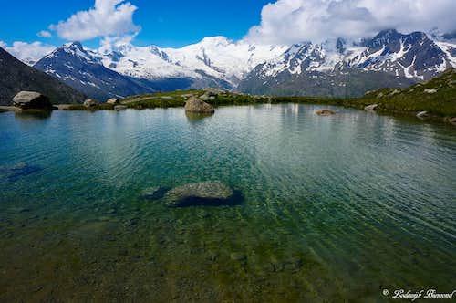 Alphubel (13799 ft / 4206 m) & the green Kreuzboden Lake