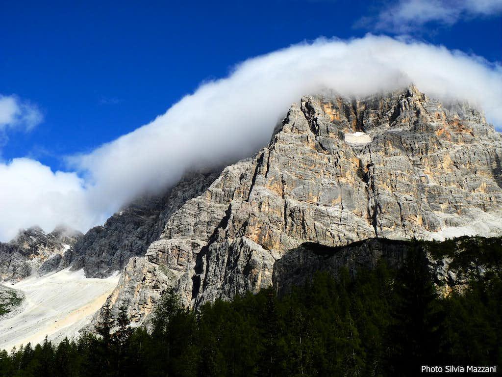 Cloud embracing Pelmo summit ridge