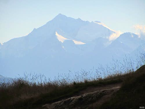 The distant, massive Weisshorn (4506m) towering over the pointy Brunegghorn (3833m)